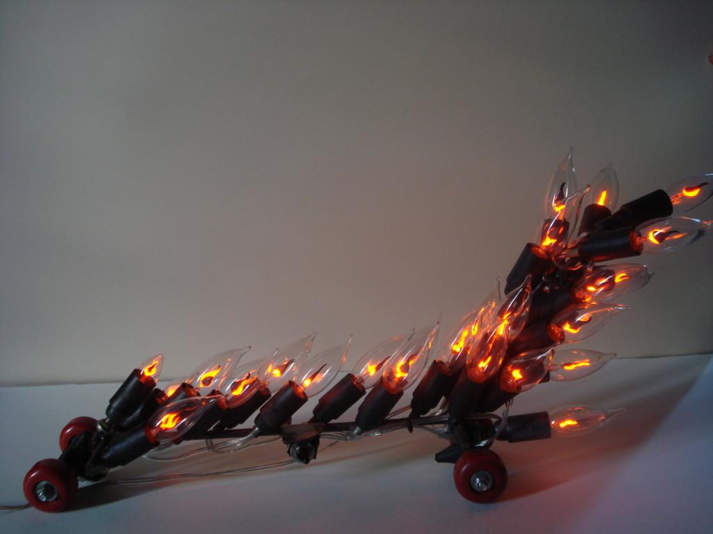 """""""Bolide""""  2010 ferro e lampadine a fiamma 31x69x15 cm"""