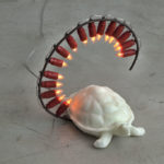 """Tartaruga felice"" Cera microcristallina, ferro, luce a fiamma 35x30x40 cm. Foto Claudio Abate"