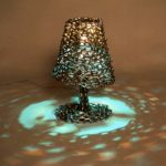 """Lampada"" 1995, ferro, luci, 58x28x32 cm."